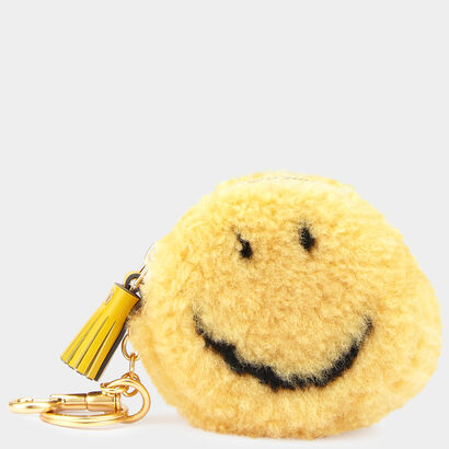 Smiley Shearling Coin Purse by Anya Hindmarch