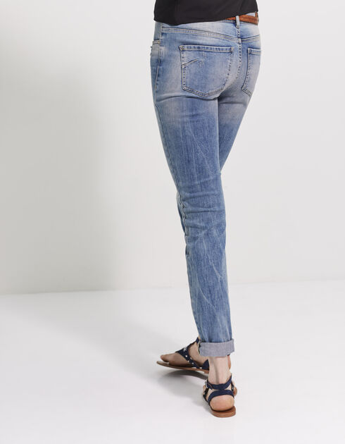 Women's destroyed blue jeans