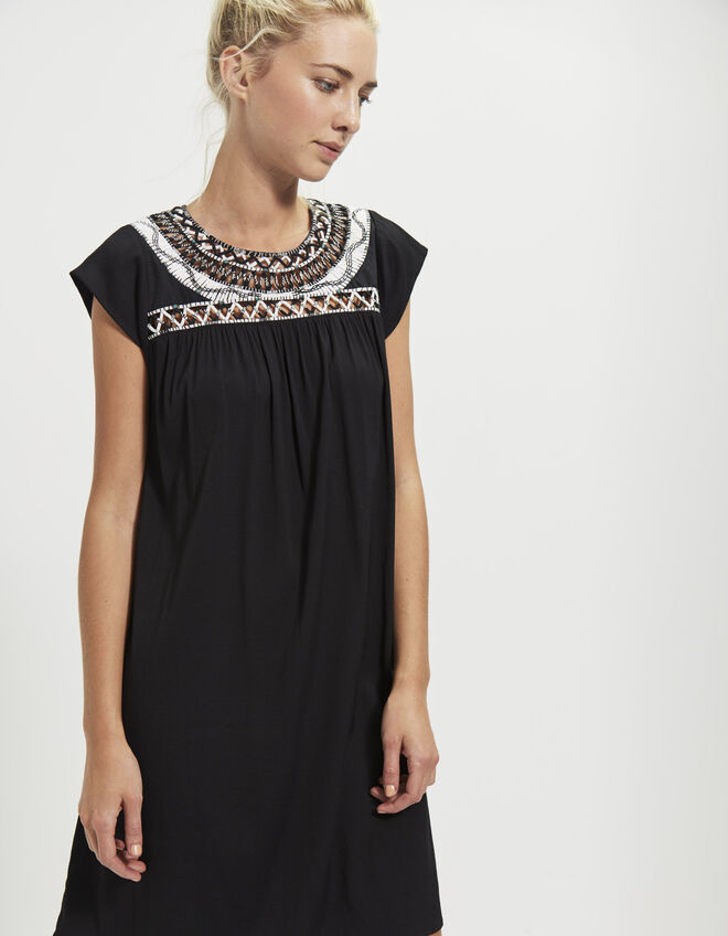 Dress with embroidered panel
