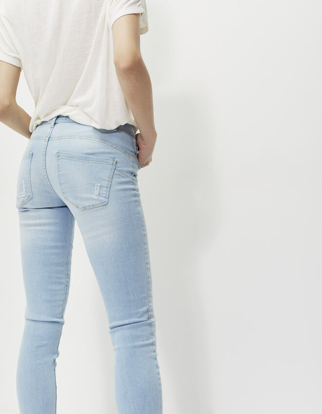 Women's destroyed blue skinny jeans