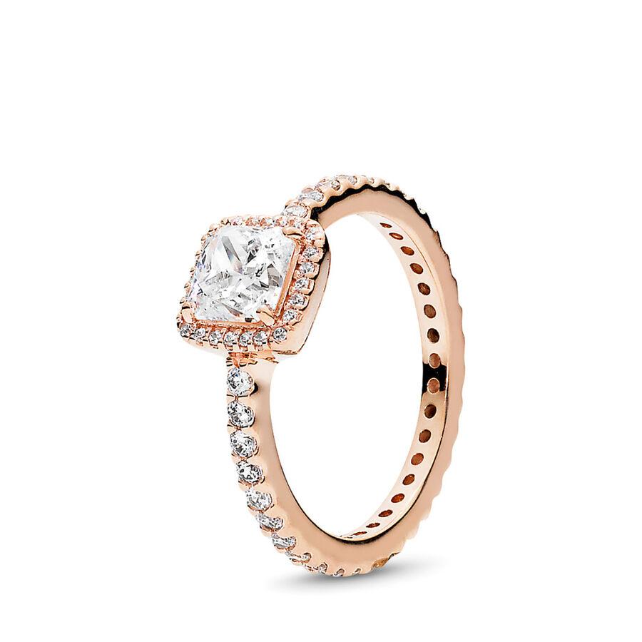 Artikel klicken und genauer betrachten! - Pandora Ringe 180947CZ-58 - Inspiriert von antiken Schmuck Designs ist dieser bezaubernde Ring eine moderne Interpretation eines Klassikers. Ein großer Cubic Zirkonia im Donauschliff umrahmt von funkelnden Stein-Akzenten gibt diesem zeitlosen Ring einen angesagten Vintage Look und macht ihn zu dem perfekten Begleiter für jeden Tag. Unsere PANDORA ROSE Kollektion ist aus einer einzigartigen Metall-Legierung gefertigt und mit 14 Karat Roségold plattiert. - 180947CZ-58 Pandora Ringe   im Online Shop kaufen