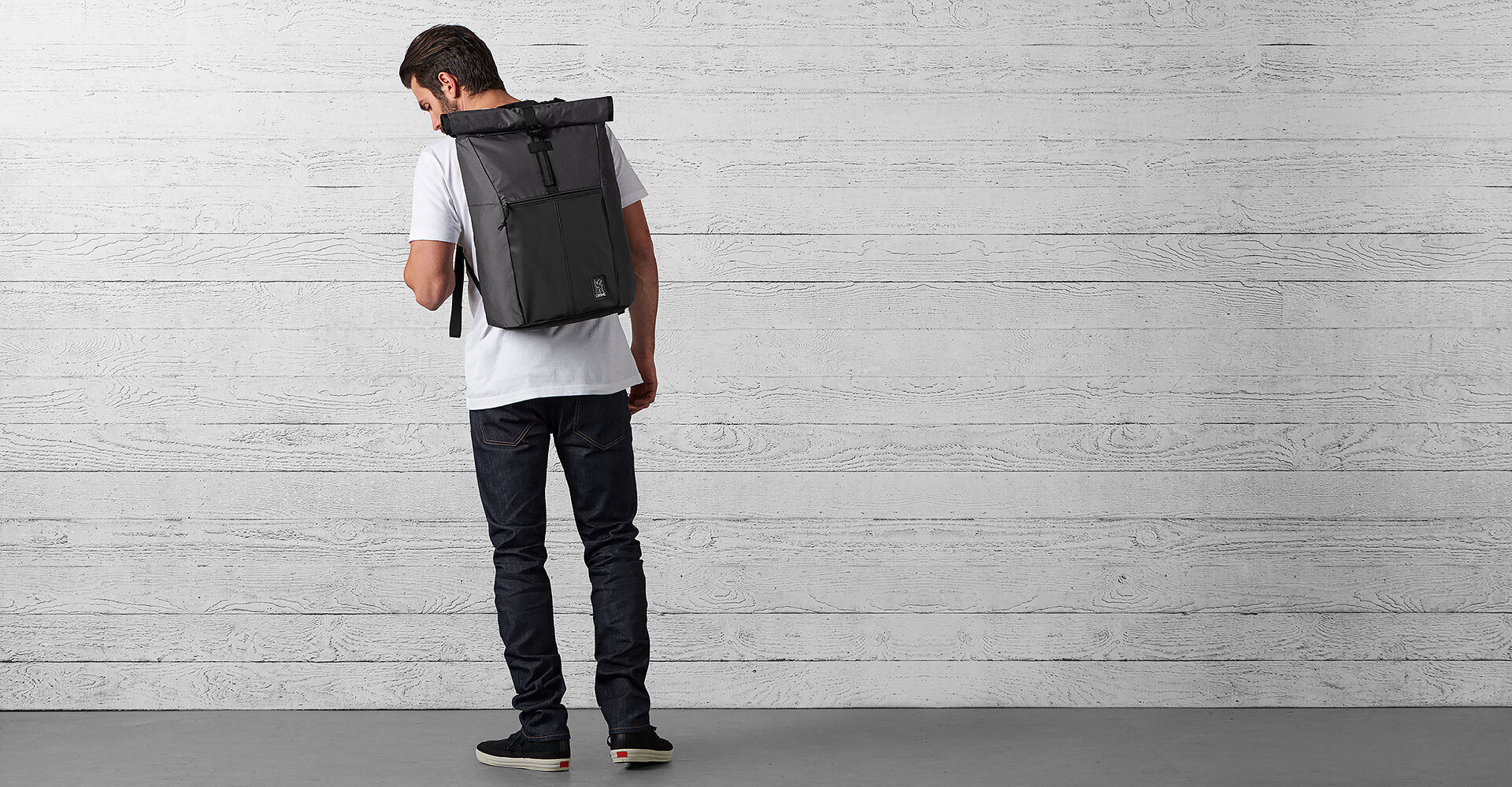 The Welterweight Yalta 2.0 Backpack in Charcoal / Black - wide view.