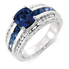 Ring with Created Sapphire & 0.15 Carat TW of Diamonds in Sterling Silver