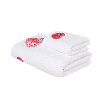 Set consisting of solid colour face towel and guest towel in 100% cotton terry with heart embroidery