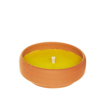 Citronella candle in terracotta pot