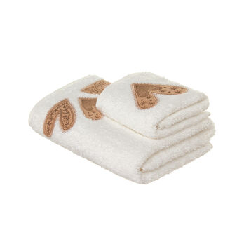 Set consisting of solid colour face towel and guest towel in 100% cotton terry with hearts and embroidery