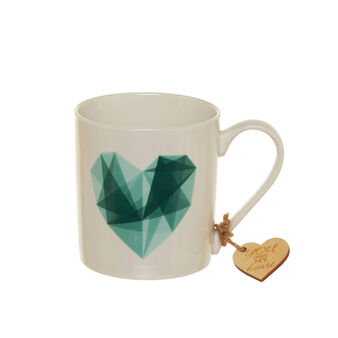 Porcelain mug with green heart decoration