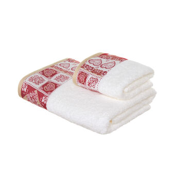 Set consisting of solid colour face towel and guest towel in 100% cotton terry with hearts
