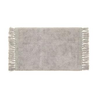 Cotton bath mat with fringes.