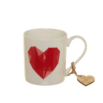 Porcelain mug with red heart decoration