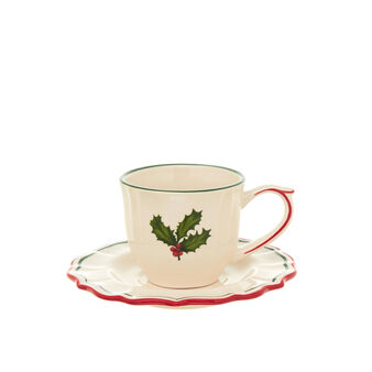 Ceramic tea cup with holly decoration