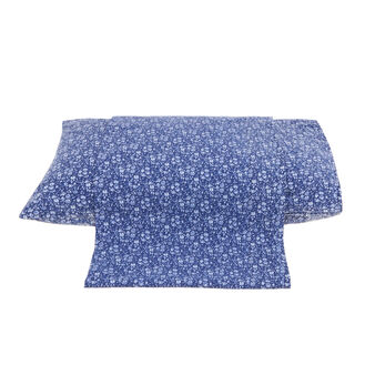 Denim-effect cotton flat sheet with floral print.