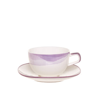 Porcelain tea cup with blended decoration