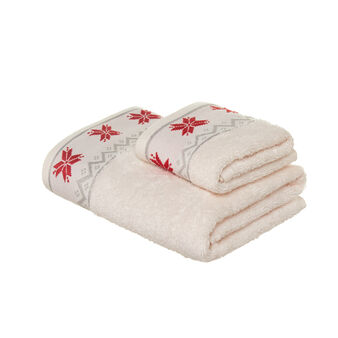Set consisting of solid colour face towel and guest towel in 100% cotton terry with Christmas embroidery