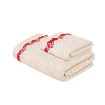 Set consisting of solid colour face towel and guest towel in 100% cotton terry with lace edging