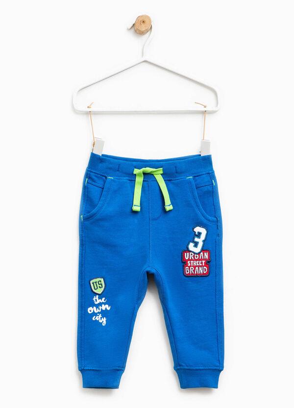 Pantaloni tuta patch e stampa lettering | OVS
