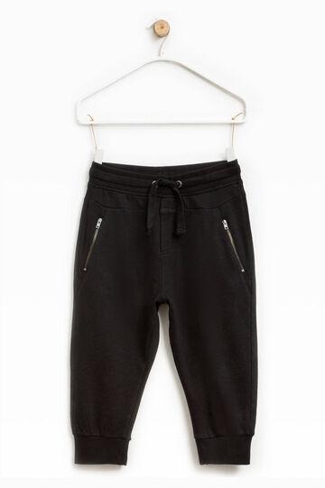 Pantalón con cremallera y cordón de ajuste