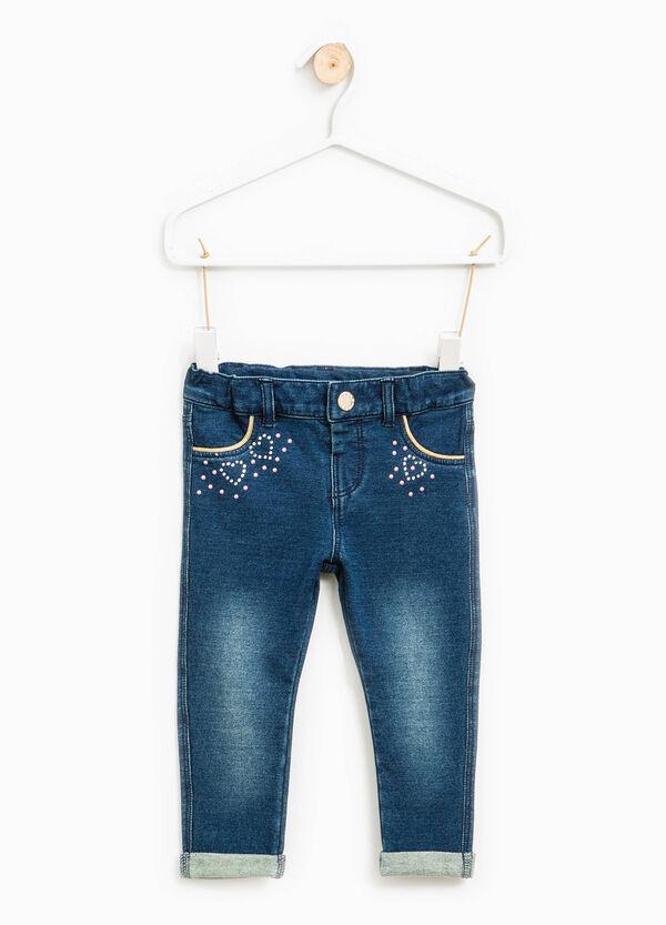 Jeans stretch con strass e risvolto | OVS