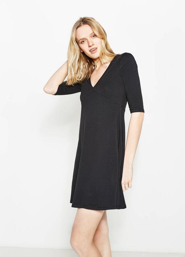 Vestido en algodón elástico con escote de pico | OVS