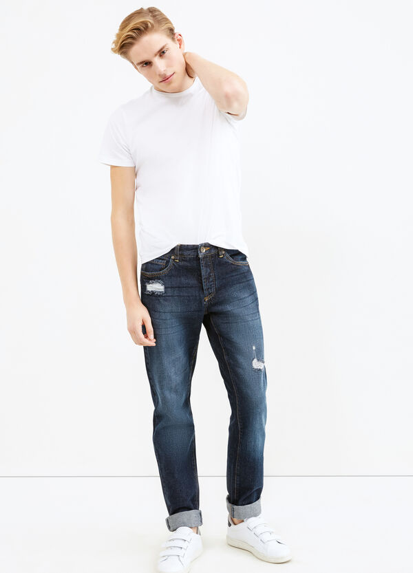 Used-effect jeans with rips and whiskering | OVS