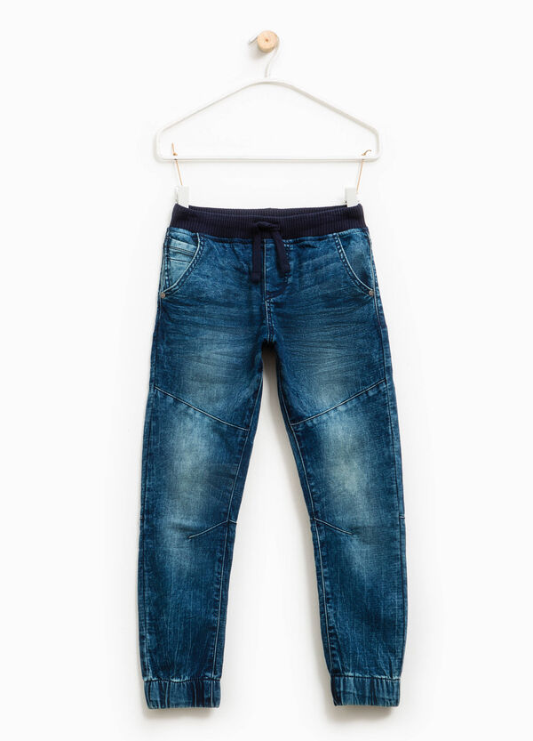 Worn-effect stretch jeans with drawstring | OVS