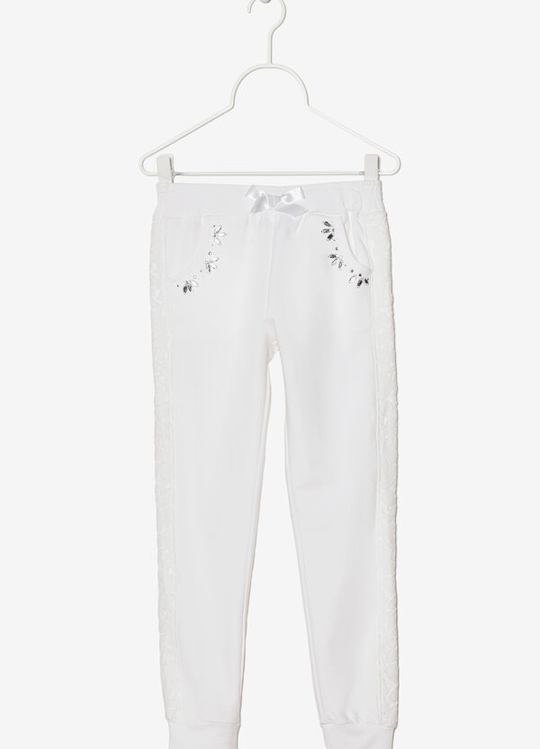 Stretch trousers decorated with rhinestones and bows | OVS
