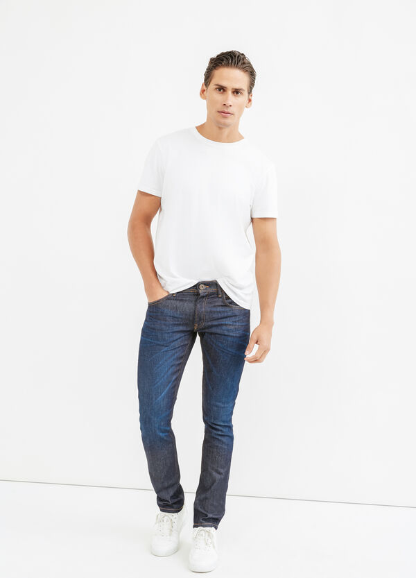 Worn-effect slim-fit jeans with whiskering | OVS