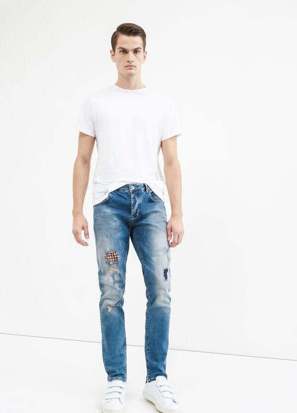Jeans stretch con strappi effetto used | OVS