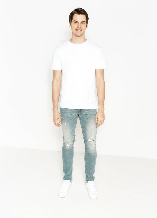 Skinny-fit, worn-effect, ripped jeans | OVS