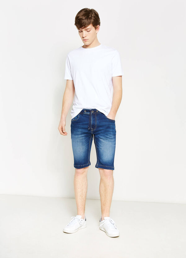 Slim-fit denim Bermuda shorts with whiskering | OVS
