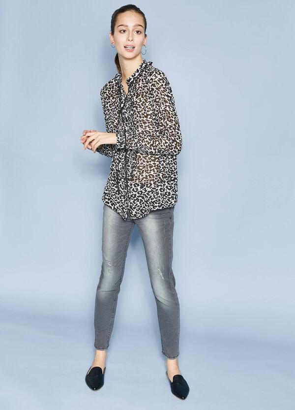 Jeans stretch effetto used con strappi | OVS