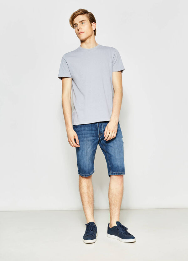 Slim-fit denim Bermuda shorts with rips | OVS