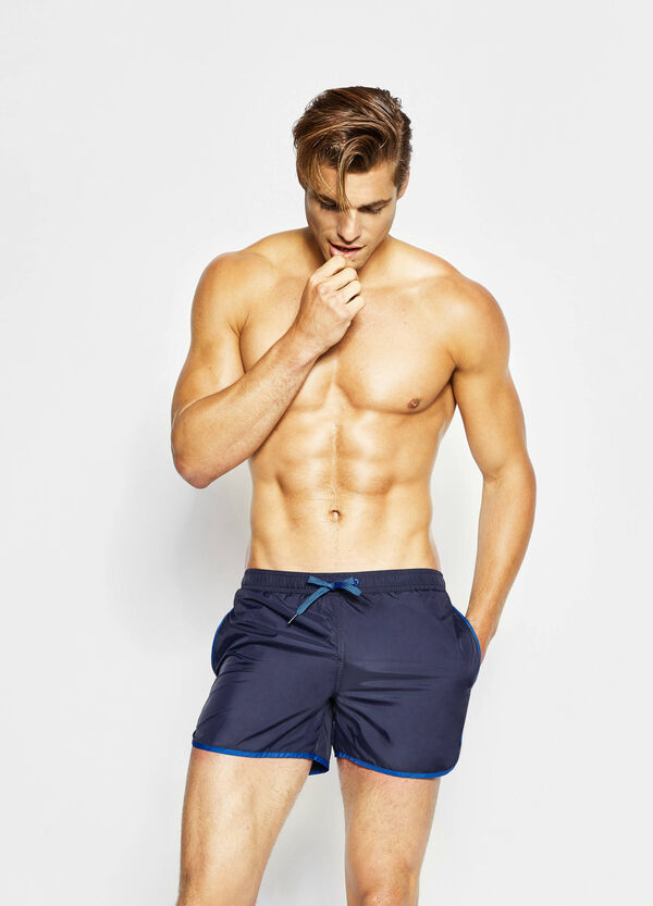 Beach shorts with edging in contrasting colour | OVS