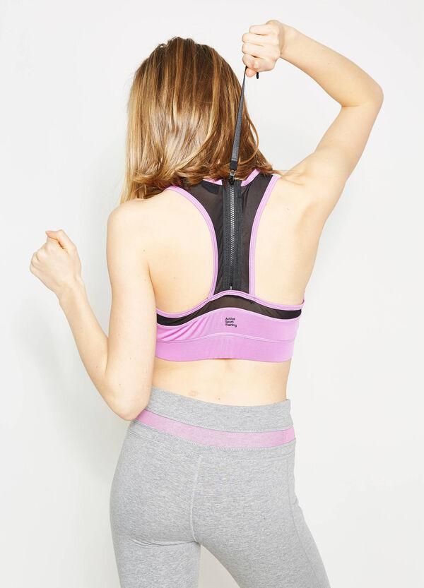 Top corto en tejido elástico de color liso | OVS