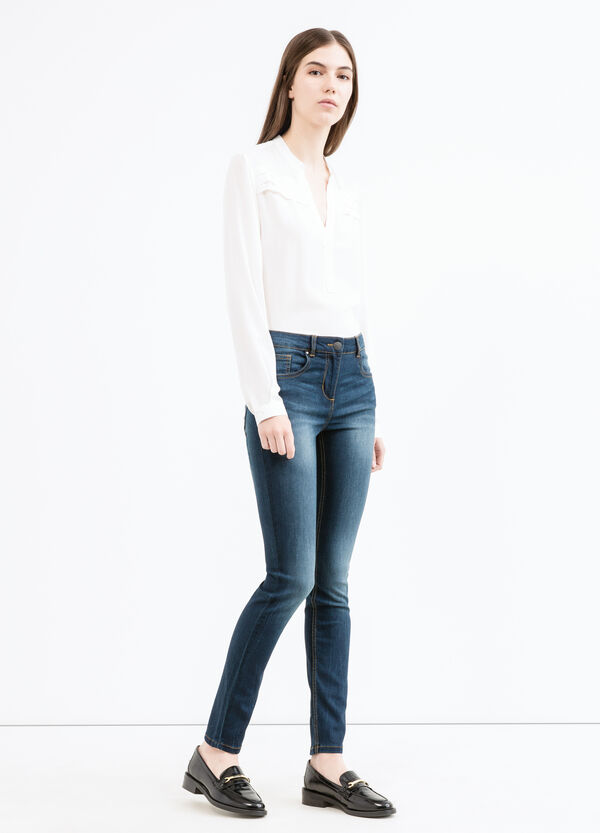 Washed and faded effect stretch jeans | OVS