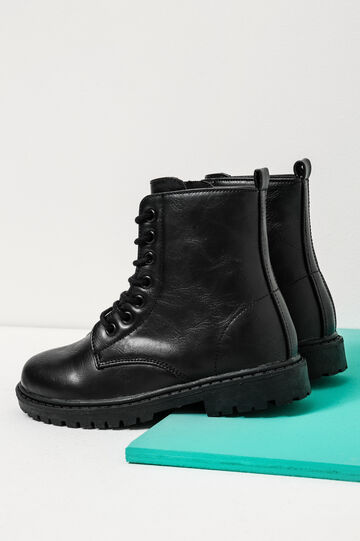 Combat boots with thick tread sole