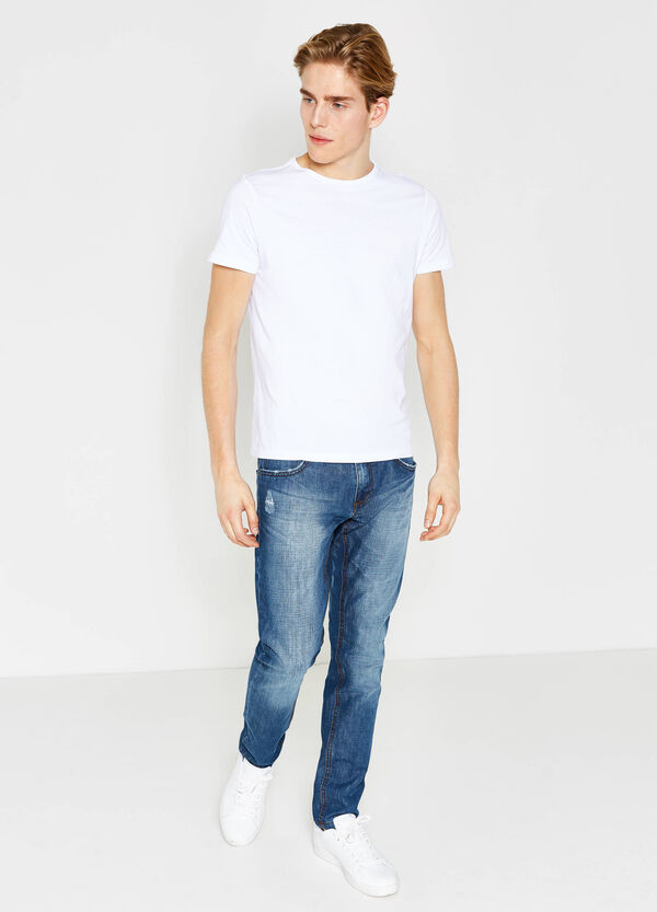 Worn-effect slim-fit jeans with abrasions | OVS