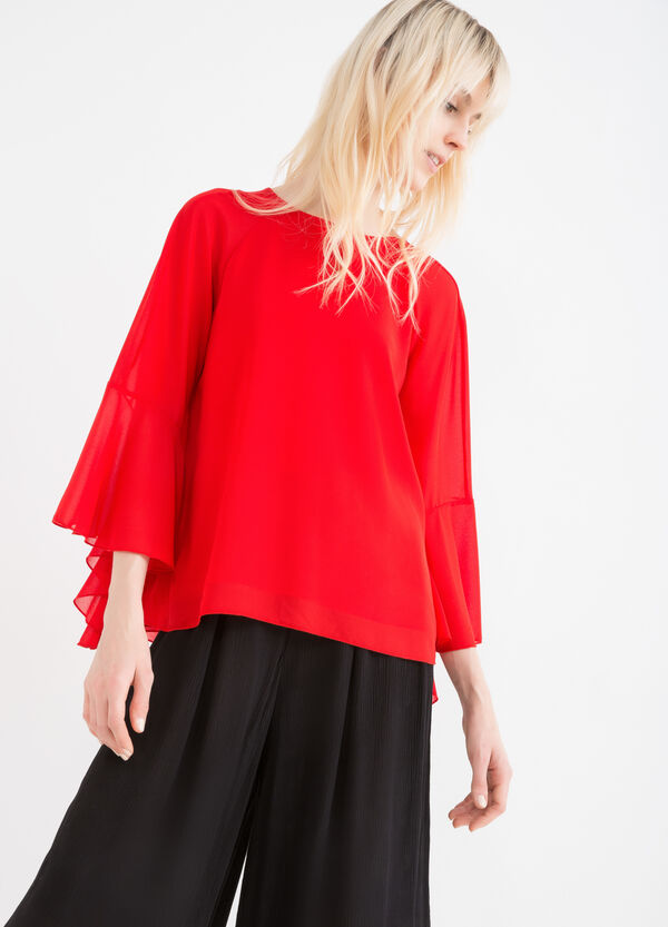 Solid colour blouse with rear vent. | OVS