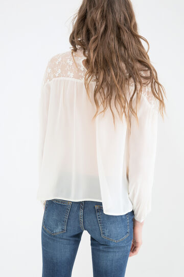 Solid colour embroidered blouse