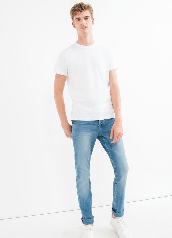 Jeans stretch con effetto used | OVS