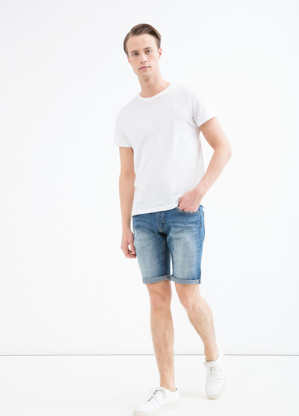 Skinny-fit stretch denim Bermuda shorts. | OVS