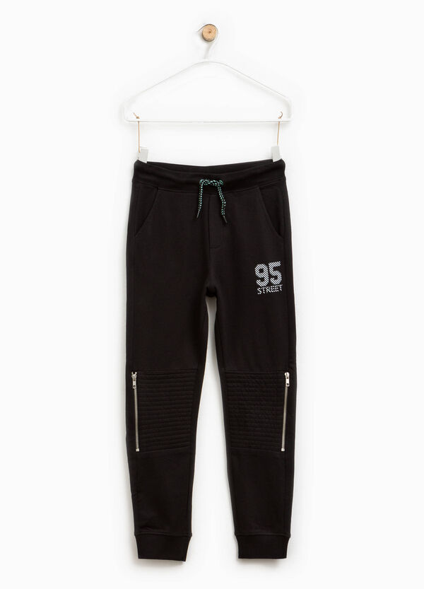 Trousers in cotton with print and zip | OVS