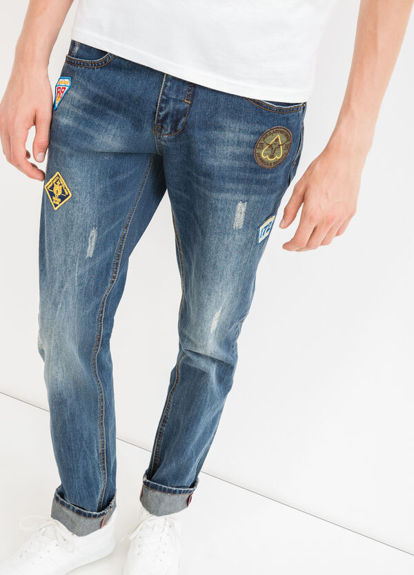 Straight-cut worn-effect jeans with abrasions | OVS