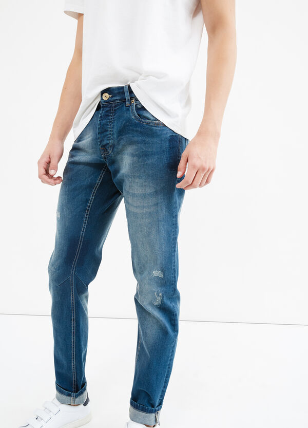 Worn-effect, skinny-fit jeans with abrasions | OVS