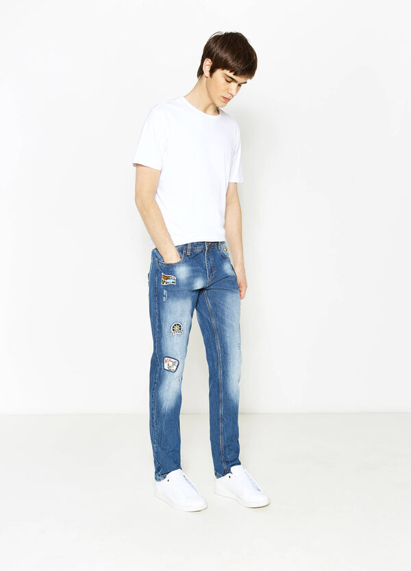 Slim-fit worn-effect jeans with patches | OVS