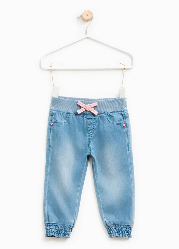 Washed-effect jeans with bow | OVS