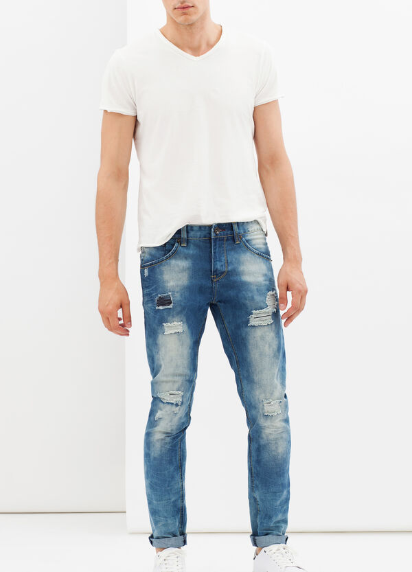 Slim fit jeans with rips and stitching | OVS