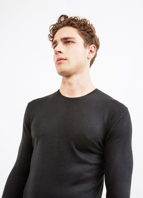 Jersey de cuello redondo en color liso. | OVS