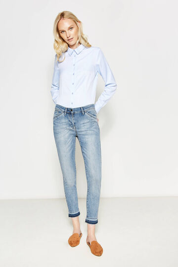 Stretch jeans with fringed hem
