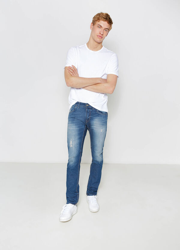 Slim-fit worn-effect jeans with rips | OVS